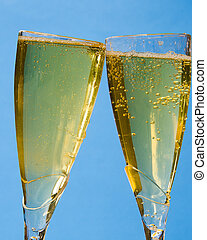 Champagne Toast - Two Glasses filled with sparkling wine