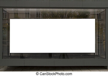 Blank poster in the window on the first floor of building,...
