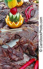 Marinated Lamb Roasted in Brick Oven Closeup - Marinated...