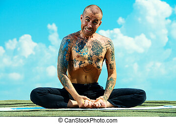 master making faces - Yoga concept. Experienced yoga master...