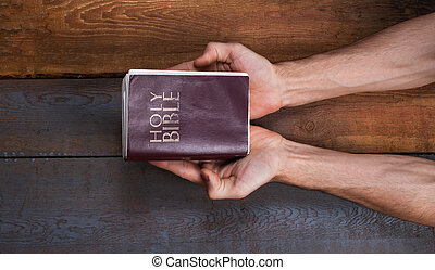 The prayer on the Bible. Hands on the Bible