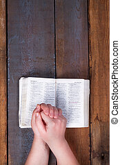 The prayer on the Bible.