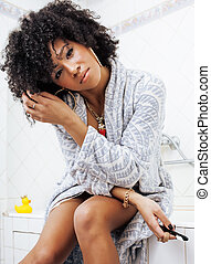 beauty young african american woman in bathrobe with tooth...