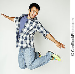 young pretty asian man jumping cheerful against white...