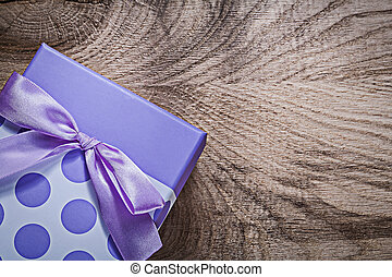 Gift box on wooden board directly above celebrations...
