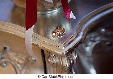 gold wedding rings on the table, close up - The gold wedding...