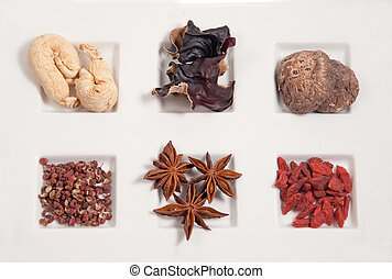 chinese herbs for cooking - clockwise, l to r: gingseng,...