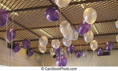 Colorful balloons floating on the ceiling indoors