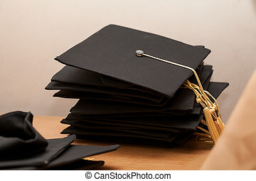 Graduation hat on wooden table