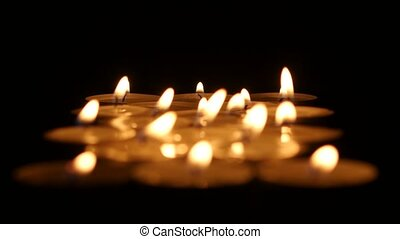 Burning candles background. Clouse up - Many candles, the...