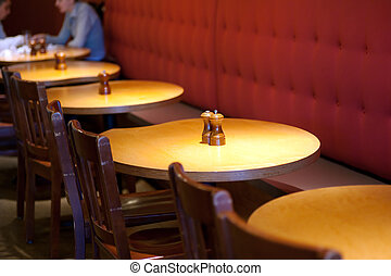 cafeteria tables - row of round restuarant tables