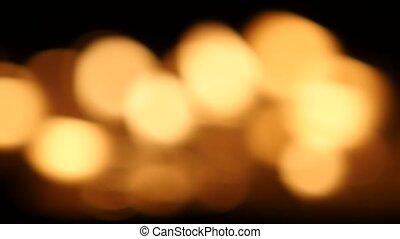Defocused background candles. Bokeh - Blurred candle, the...