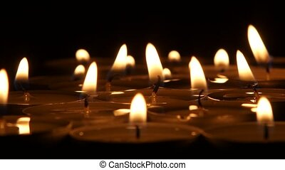 Burning candles extinguished. Close up - Burning candles in...