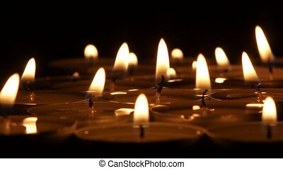 Illustration of Candle burning in the dark, Close up -...