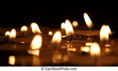 Candles in the dark. Close up - Candles, liquid wax, ?andles...