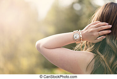 Young adult woman enjoying the bright day outdoors