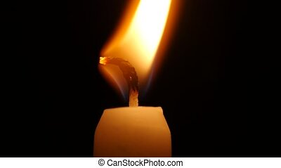 Flame of the candle. Close up - Burning candle in the dark,...