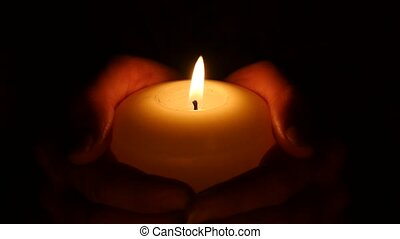 Candle in hand. Close up - Female hand holding a candle, the...