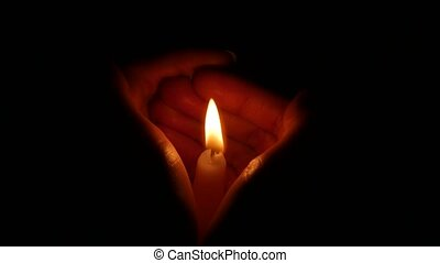 Burning candle in female hand. Close up - Candle in female...