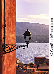 Elba, Portoferraio street lamp view on the sea on sunset. Tuscany, Italy