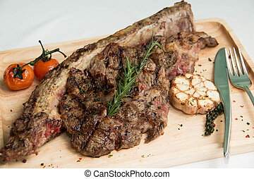 grilled tomahawk beef steak cut with fresh rosemary and...