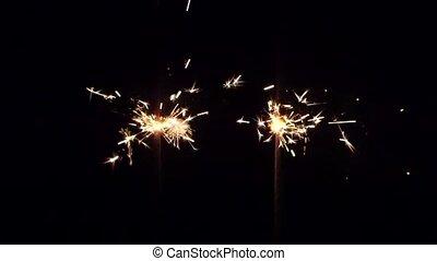 Burning bengal fire. Close up - Yellow sparkler, bengal...