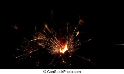 Sparkler on black background. Slow motion - Two bengal fire,...