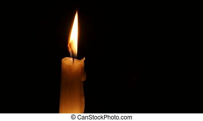 Burning wax candle. Close up - Candle burns, the wax melts...