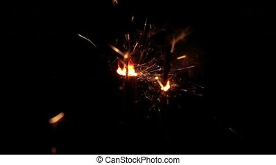 Fireworks sparkler on black background. Slow motion -...