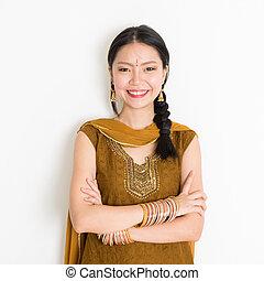 Mixed race Indian woman in sari dress