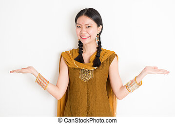 Mixed race Indian woman showing something - Portrait of...