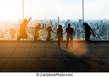 Silhouette group of business men and women happy jumping on...