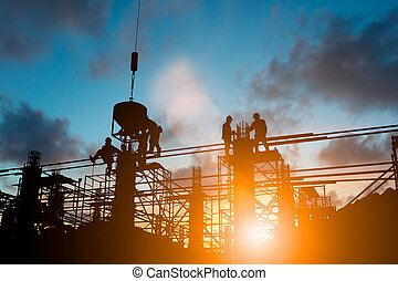Silhouette engineer control standards and agreed business contract over blurred natural background sunset pastel. Heavy industry and safety at work concept.