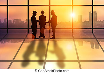 Silhouette team of successful business engineer people talk...