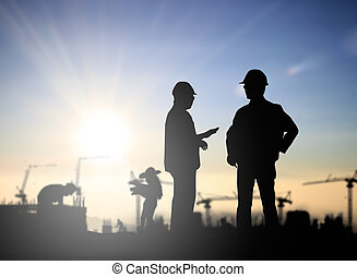 Silhouette Successful male engineer standing survey work on...