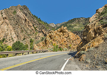 Paved Road Through the Mountains - Two-lane winding road...