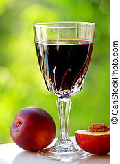Glass of red wine and fruit.