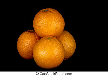 Organic Oranges Isolated on a Black Background - Organic...