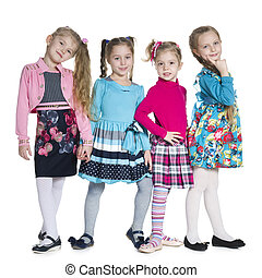 Fashion little girls stand against the white - Group of...