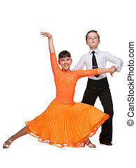 Dancing children - Young boy and girl are dancing on the...