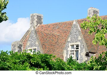 Large stone cottage behind trees - Large stone cottage...
