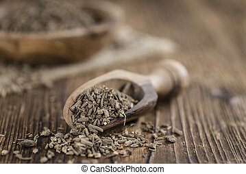 Heap of valerian roots (close-up shot)on vintage wooden...