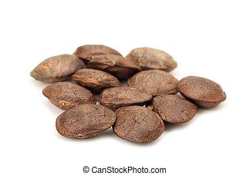 sacha inchi seeds isolated on white background