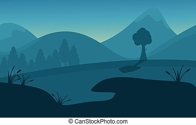 Silhouette of mountain tree and lake
