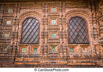 Antique windows in a red brick wall