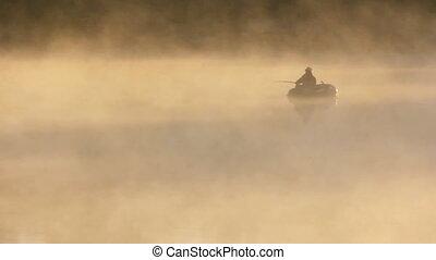 morning fishing in fog - morning fishing on river in fog
