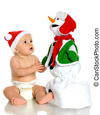 Snowman Admiration - A handsome baby boy in a Santa hat...