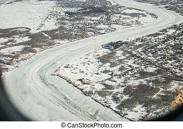 Aerial view of the great river with floating ice floes...