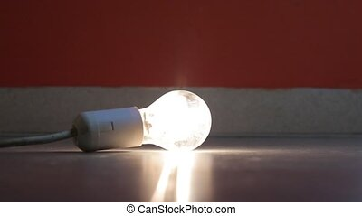 Flickering lightbulb on the floor - Lightbulb flickering on...