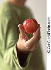 Red apple in hand